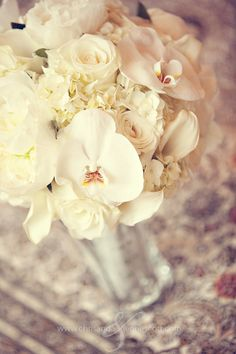 White orchids, roses, and and hydrangeas! I want my bouquet to look like this but not roses