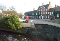 Hop Pole Hotel in Ollerton old village with River Maun in foreground