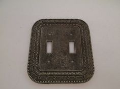 fabulous vintage 1970s metal cast switch plate cover for double toggle .. French…