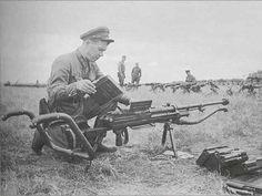 Soviet officer loading up anti-tank rifle