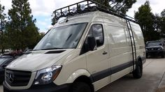 Mercedes Sprinter 4x4 with aluminum off-road voyager roof rack with tight slat flooring and side ladder.