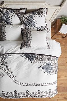 This winsome textural rug features a pastoral motif, bordered on both ends by tufted sheep. black and white bohemian duvet set anthropologie affiliate link
