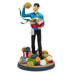 """Make a bold statement this holiday season with the Star Trek Tribble Tabletop Figure featuring Spock unwrapping his curious gifts. It's only logical that you include this 8"""" figure in your holiday table centerpiece."""