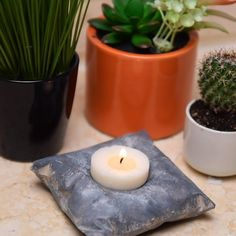 Check out this cool cement like candle pillow holder! Check out this cool cement like candle pillow holder! Concrete Candle Holders, Diy Candle Holders, Diy Candle Lantern, Candle Wax, Votive Candles, Candle Sconces, Tea Light Candles, Tea Lights, Diy Candles Video