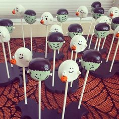 Halloween cuteness overload! Adorable Frankenstein and ghost cake pops displayed in Halloween cake pop stands: