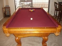 "For sale: 8' x 4' pool table in really nice condition. If I remember correctly it has a 1"" slate. Includes full set of balls, 2 pool stick racks, 9 pool sticks, 2 table brushes, 11 blue chalk squares,..."