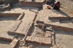 A small tank made with wedge-shaped burnt bricks and the channel that carried water into it. The tank measured 130 cm x 130 cm on the outside. Harappan craftsmen used the water in the tank mainly for cooling the beads they made. Photo:V. Vedachalam