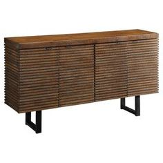 """Accented by open metalwork legs, this routed wood credenza combines eye-catching appeal with convenient storage. Features ample shelving behind 4 doors.   Product: CredenzaConstruction Material: Wood and metalColor: Rustic brownFeatures: Four doorsInterior shelvesDimensions: 33.5"""" H x 62"""" W x 14.5"""" D"""