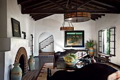 Image from http://homedesignboard.com/wp-content/uploads/2014/06/Spanish-Colonial-Living-Room.jpg.