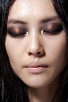 smoky eye makeup with black & bronze