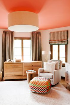 Bright nursery with coral ceiling and colorful details throughout