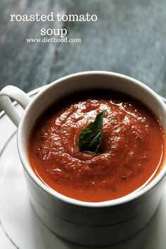 Slurp up this Roasted Tomato Soup! A delicious Roasted Tomato Soup made with garden fresh tomatoes, garlic, onions, and basil. | #recipe #tomatosoup #soup