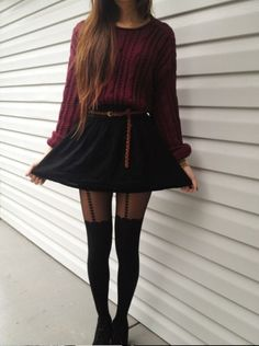 A Dark Red Sweater Tucked Into A Leather Skirt Perfectly Paired With A Brown Belt And Tights, Cropped At The Thigh Leading. A Trail Of Hearts All The Way Up