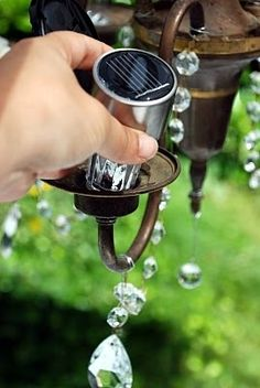 Replace the light bulbs in an old chandelier with inexpensive solar lights. Hang it from a tree branch. You'll have gorgeous outdoor lighting without having to provide electricity. GREAT  for an Evening Garden Party , ( even for just the two of you ) -Wedding, Birthday and Anniversary Celebrations could be enhanced by this.