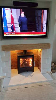 Fake chimney breast with Twin wall chimney system TV recess with a Focus Pale Oak beam Bideford chamber with Heta Ambition stove Brick Fireplace Mantles, Wood Burner Fireplace, Home Fireplace, Fireplace Remodel, Fireplace Design, Fireplace Ideas, Fireplaces, Living Room With Stove, Log Burner Living Room