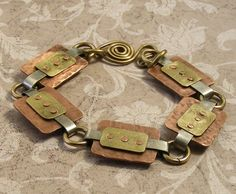Cold connected rectangle bracelet. This resembles a pair of earrings recently saved:)