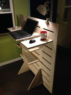 This is our standup desk with multiple configurable shelves for storage on both sides. They're made to be adjustable and versatile to match your work style, and easy to move around as daily and seasonal light changes. Reposition the center shelf to sit or stand with a laptop, and keep your health in balance!