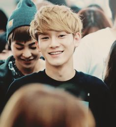Chen with a smiling Xiumin behind him