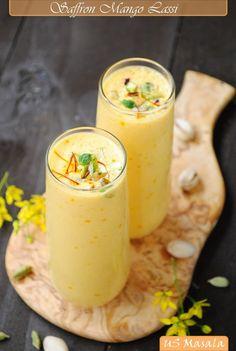 Saffron Mango Lassi - mango, yogurt, milk, ice, cardamom powder, sugar, saffron, ginger, rose water, and cashews/pistachios for garnish