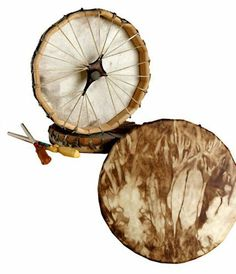"""Native American Frame Drum 13"""" Diameter by World Wide Drums, LLC. $115.00. Hand made by an experienced craftsman in Minnesota. These drums sound as beautiful as they look. The frame is constructed from cedar wood stays and the drum head is made from deer hide. The drum is stained with a walnut finish. Drum stick included."""