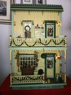 My Miniature Antique Shop, in a Walmer Front Opening Storefront Building. I created this to use as a safe for things for future projects,but once inside nothing has come out! (jt-see Dollhouse/JWilliams Collection board for more pics of this great shop.. lots of detail!)