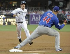Game #112 8/6/12: Chris Denorfia #13 of the San Diego Padres gets caught off first base in a double play by Anthony Rizzo #44 of the Chicago Cubs during the first inning of a baseball game at Petco Park on August 6, 2012 in San Diego, California. (Photo by Denis Poroy/Getty Images)