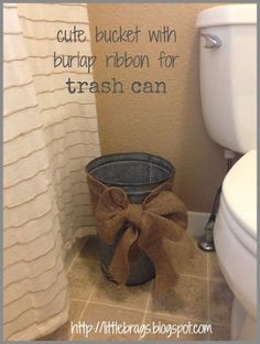 decorating with rusty buckets, bathroom ideas, home decor, Old flower bucket made into a trashcan with burlap ribbon