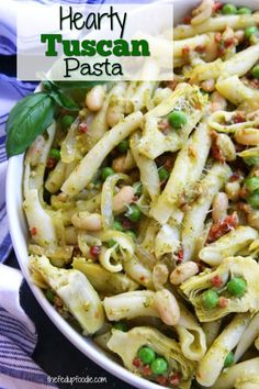 Hearty Tuscan Pasta recipe has cannellini beans, pancetta, sun-dried tomatoes, artichoke hearts, peas and pesto. Comes together within a half hour and is the perfect meal to impress company. This is my new favorite go to pasta. Healthy Eating Recipes, Real Food Recipes, Cooking Recipes, Easy Homemade Recipes, Easy Pasta Recipes, Party Recipes, Ravioli, Tuscan Pasta, Avocado Pesto Pasta