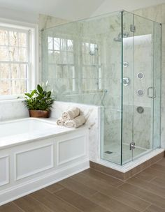If you already have a basic built-in surround but feel your bathtub could use some visual interest, add faux-panelling.