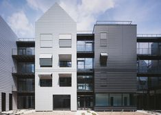 Concertina shutters shade the windows of this Paris retirement home.