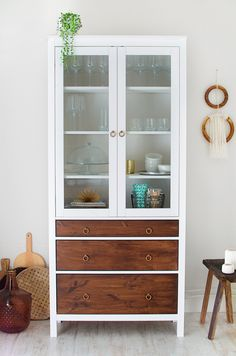 Love this. The cabinet is an IKEA hack, just like the wallhanging right next to it.