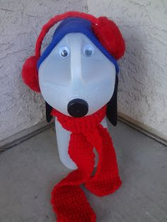The Busy Broad: Milk Jug Snoopy Porch Decoration.  Please excuse his crooked ear muffs