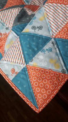 Triangle baby quilt.  Uses fabric line #cyclesoflife