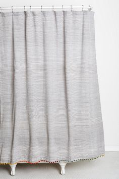 Thinking of a new shower curtain…this could be it. ~LD Magical Thinking Yarn-Dye Pompom Shower Curtain