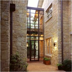 Love this combo for the exterior facade of a house: stone walls to welcome you and glass door that gives a modern touch. Love this combo for the exterior facade of a house: stone walls to welcome you and glass door that gives a modern touch. Design Exterior, Modern Exterior, Door Design, Wall Exterior, Modern Entry, Rustic Modern, Stone Exterior Houses, Exterior Doors, Austin Stone Exterior