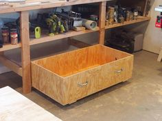 Like most wood shops that have an open area under the workbench, it quickly gathers all of the left over pieces and scrap wood underneath. These easy to make drawers can help with that.
