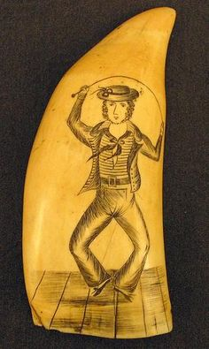 A scrimshaw whale tooth (crica 1850) etched with a sailor dancing a hornpipe