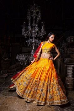 Sangeet Lehengas - Bright Yellow Lehenga with Silver Embroidery and Copper Border and Red Net Dupatta | WedMeGood #wedmegood #indianbride #indianlehenga #bridal #lehenga #indianwedding #yellow