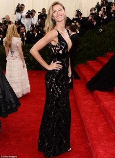 Blonde beauty: The 33-year-old star looked sublime in a floor-length black gown featuring ...