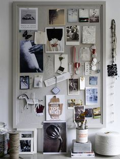 I love the cool grey of this mood board and the mix of pendants and mementos hung from ribbons, letters and business cards, along with photos and paint chips