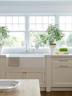 Lindy Weaver Design Associates: Beautiful kitchen with cream cabinets and marble countertop with mini subway tile ...
