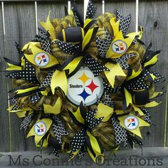 Check out this item in my Etsy shop https://www.etsy.com/listing/476918623/pittsburgh-steeler-mesh-wreath