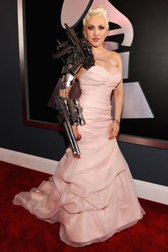 I am sorry who says a girl can't be ready for WWIII or Zombie  Attack while rocking an evening gown. She get an A.