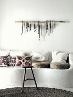 This giant rustic branch with beads is an amazing DIY project for my Abode! And I'm digging the textile ladder below.