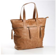 This roomy, buttery soft leather bag is available in hazelnut, tobacco or matte black. It's a great size for traveling as it fits into hand luggage or can be used as an overnight bag or for gym gear. Luxury Bags, Luxury Handbags, Lolly Bags, Gym Gear, Wholesale Bags, Buy Shoes, Leather Handbags, Leather Bags, Travel Bags