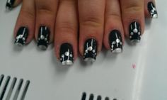 Black with silver pearls nail art