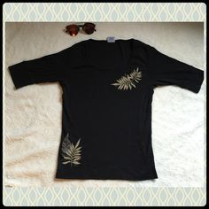 Crazy Shirts Black 3/4 Sleeve Shirt w/ Leaf Design Rainforest Iki Black Rib Knit Shirt. Purchased in Waikiki, Oahu from Crazy Shirts. NWOT/Never used. Incredible soft cotton.  Size small.  Sensational style starts with our ladies shirt for a look that works in town or on the beach. Luxurious 100% combed, ring-spun cotton means you won't sacrifice comfort for style. Design Placement: Medium print embroidery on left front shoulder area and right front hip. ❌TRADES ❌PAYPAL 💯 POSH RULES 👍…