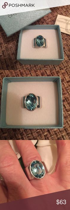 Touchstone Crystal by Swarovski Aquamarine Ring. Stunning ring. Large aquamarine Swarovski Crystal stone and thick band. A statement piece. Rhodium plated.  Worn a few times on special occasions. Swarovski Jewelry Rings