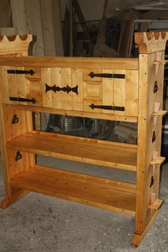 Hmmm ... this links to a picture on Facebook, which since I'm not, I can't see get more details.  It looks like some of the mortise, tenon & peg camp shelving I've pinned before with an added closed cabinet at the top.