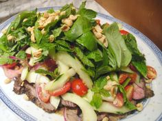 I've got to hand it to Wells—her Thai Beef Saladbeats the pants off of any Thai takeout version I've encountered.  With a base of juicy rare roast beef slices marinated in a lime-fish sauce dressing, the salad is composed of thinly sliced cucumbers and red onion, chiles, and sweet cherry tomatoes tossed in that same fantastic dressing. On top of the veggies go a shower of bright herbs—cilantro, mint, basil, and kaffir lime leaves if you can find them—as well as a handful of salty roa...